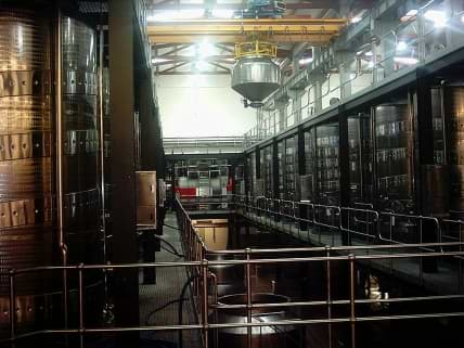 Automated position control 10 ton crane system for gravity feed wine cellar.